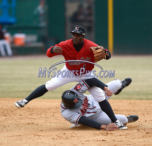 4/4/2014 Mike Orazzi | Staff Rock Cat's Corey Wimberly (1) forces out Richmond Flying Squirrels' Ricky Oropesa (33) at second in New Britain Friday.