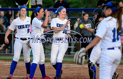 6/14/2014 Mike Orazzi | Staff Southington High School softball players celebrate during Saturday's Class LL Final with Amity at West Haven High School.