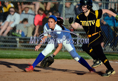 6/14/2014 Mike Orazzi | Staff Southington High School's Kaitlin Paterson (9) and Amity High School's Cassidy Kirby (4) during Saturday's Class LL Final at West Haven High School.