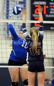 11/14/2015 Mike Orazzi   Staff Bristol Eastern Volleyball's Mikayla Martin (10) and Avon High School's Erin Sutter (10) during Saturday's win in a Class L Quarterfinal in Bristol Saturday.