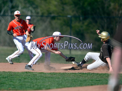 4/20/2016 Mike Orazzi | Staff Terryville's Shawn Fulton (6) applies the late tag to Thomaston's Matt Tehan (8) at second base at THS Wednesday afternoon.