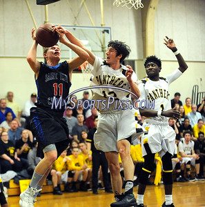 3/9/2016 Mike Orazzi | Staff St. Paul Catholic's Jackson Hines (11) and East Windsor's Tristan Givens (12) and Marcus Goss (1) during the Class S Second Round State Boys Basketball Tournament in East Windsor Wednesday night.