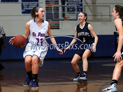 3/3/2016 Mike Orazzi | Staff St. Paul's Lizzy Cretella (21) and Immaculate's Caroline Wax (4) during the Class M Second Round in Bristol Thursday night.
