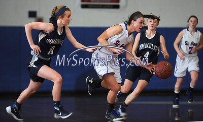 3/3/2016 Mike Orazzi | Staff St. Paul's Lizzy  Cretella (21) and Immaculate's Megan Coyle (10) and Caroline Wax (4) during the Class M Second Round in Bristol Thursday night.