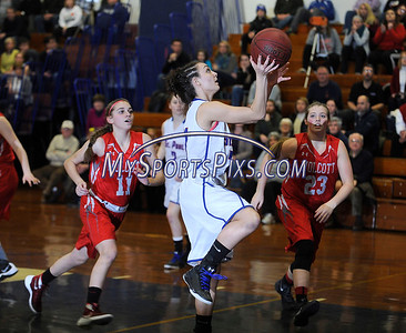 1/29/2016 Mike Orazzi | Staff St. Paul's Lizzy Cretella (21) and Wolcott's Raven Cody (11) and Jenna Hoban (23) at St. Paul in Bristol Friday night.