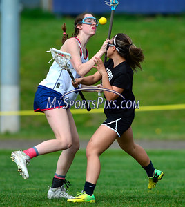 4/22/2016 Mike Orazzi   Staff S. Paul Catholic High School's Steph Speaker (3) and Bristol Co-op girls lacrosse's Aly Policarpio (4)  Friday afternoon in Bristol.