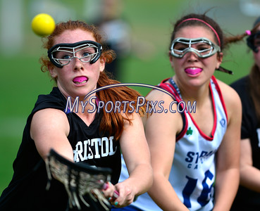 4/22/2016 Mike Orazzi   Staff Bristol Co-op girls lacrosse's Brianna Hamel (9) and and St. Paul Catholic High School's Amethyst Peterson (16) Friday afternoon in Bristol.