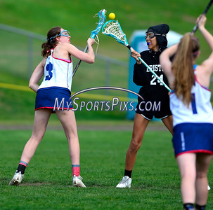 4/22/2016 Mike Orazzi   Staff Bristol Co-op girls lacrosse's Kailey Davis (24) and and St. Paul Catholic High School's StephSpeaker (3)  Friday afternoon in Bristol.