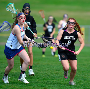 4/22/2016 Mike Orazzi   Staff Bristol Co-op girls lacrosse's Brianna Hamel (9) and and St. Paul Catholic High School's Morgan Moore (1) Friday afternoon in Bristol.