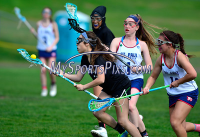 4/22/2016 Mike Orazzi   Staff Bristol Co-op girls lacrosse's Gabriele Abramczyk (23) and St. Paul Catholic High School's Morgan Moore (1) and Amethyst Peterson (16) Friday afternoon in Bristol.