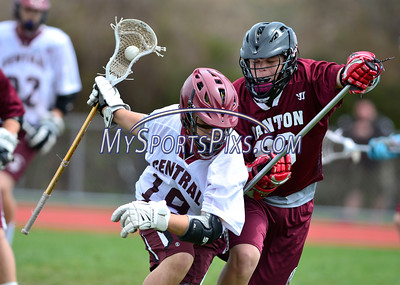 4/23/2016 Mike Orazzi | Staff Bristol Central's Nick Bouchard (19) and Canton High School's Nicholas Allen (99)during lacrosse Saturday at BCHS.
