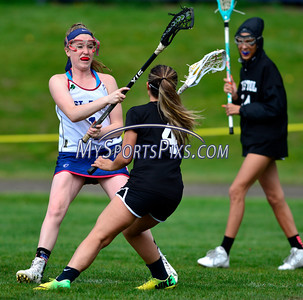 4/22/2016 Mike Orazzi   Staff Bristol Co-op girls lacrosse's Aly Policarpio (4) and and St. Paul Catholic High School's Morgan Moore (1) Friday afternoon in Bristol.