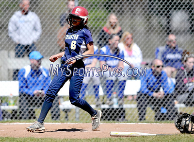 4/15/2016 Mike Orazzi | Staff Newington's Cyan Gonzalez (6) scores on Friday at Eastern.