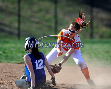 4/27/2016 Mike Orazzi | Staff Shepaug High School's Maribeth Seeger (12) slides under the tag of Terryville High School's Lexie Gonska (17) at second base Wednesday afternoon.